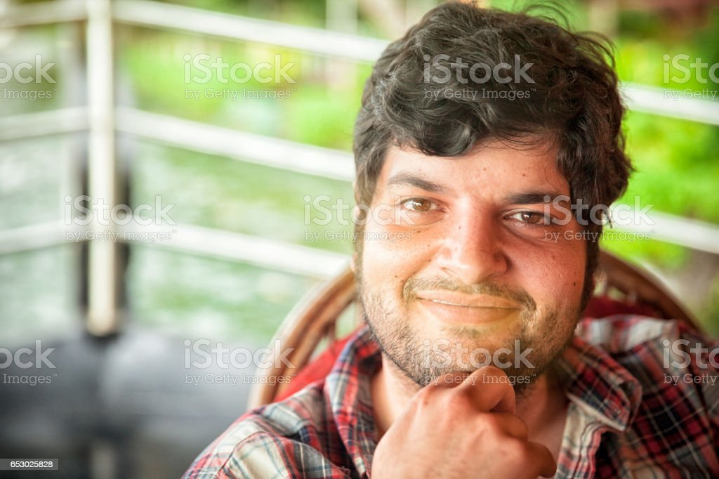Happy Man on Boat Trip in South India stock photo