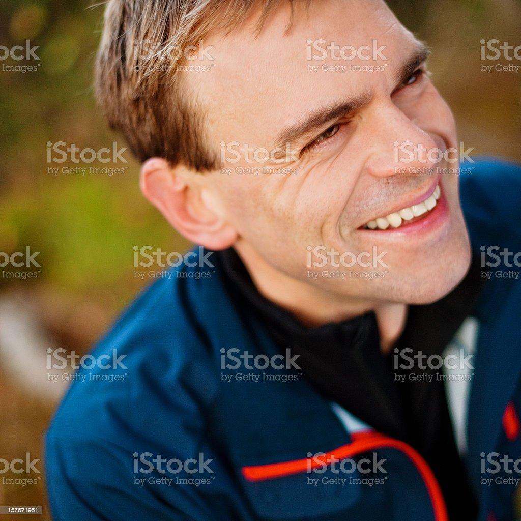 Happy man outdoors looking away royalty-free stock photo