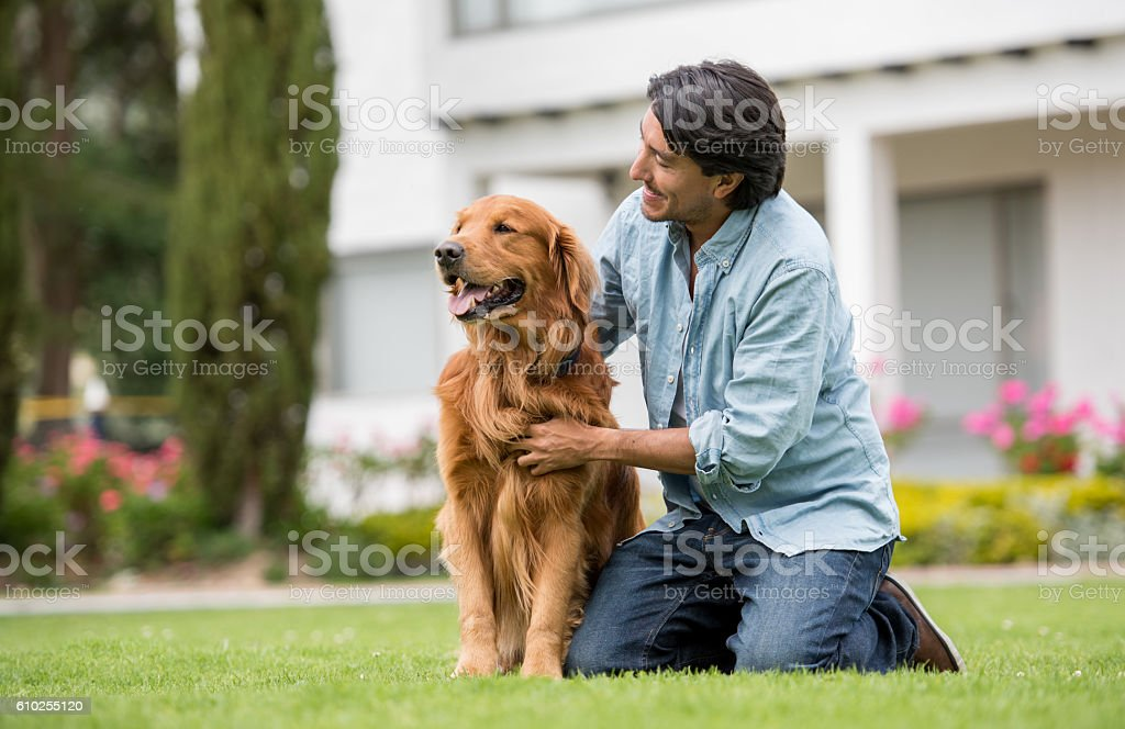 Happy man outdoors with his dog stock photo