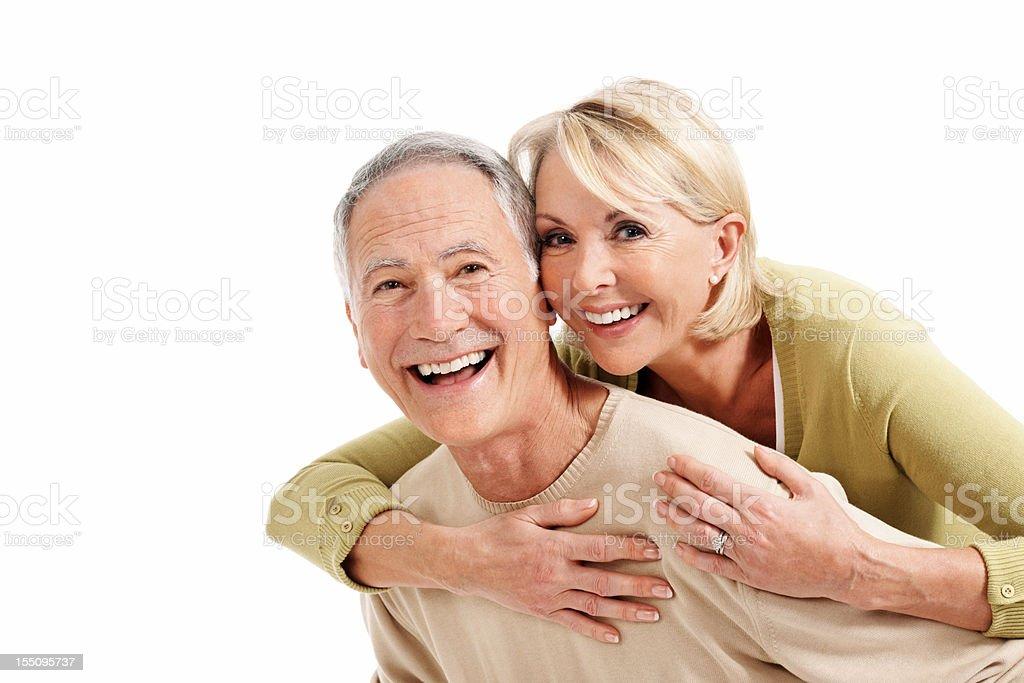 Happy man piggybacking mature woman royalty-free stock photo