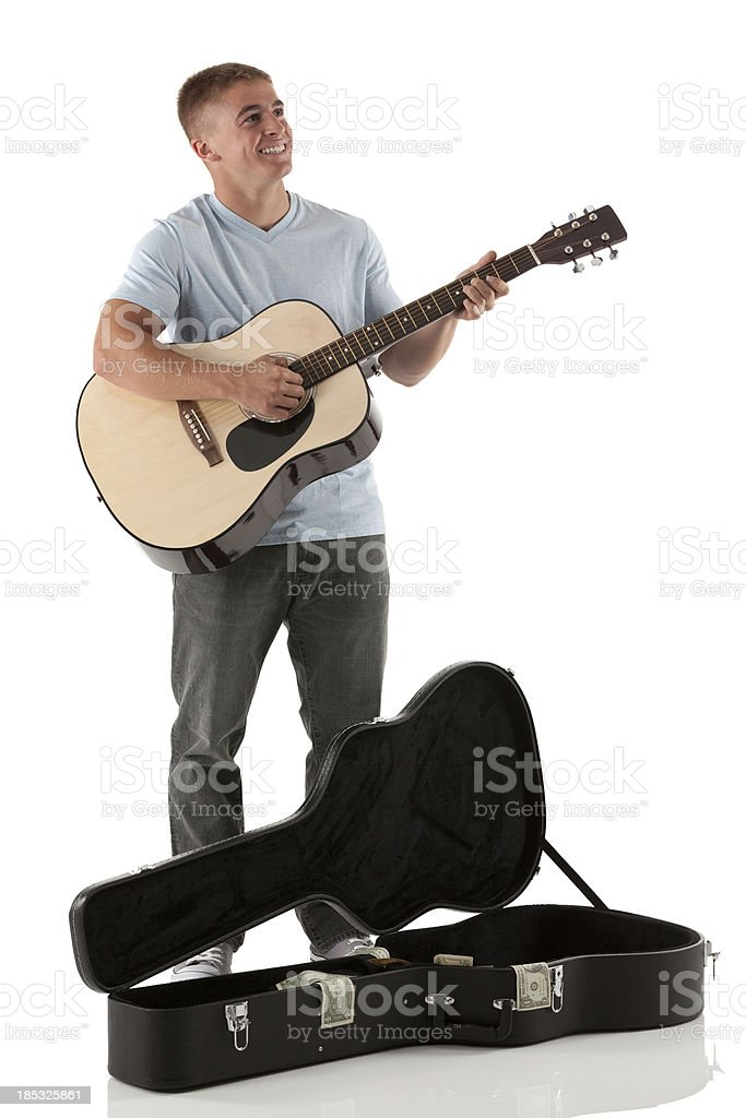 Happy man playing a guitar royalty-free stock photo