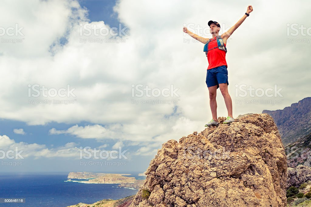 Happy man reaching life goal success inspiration stock photo