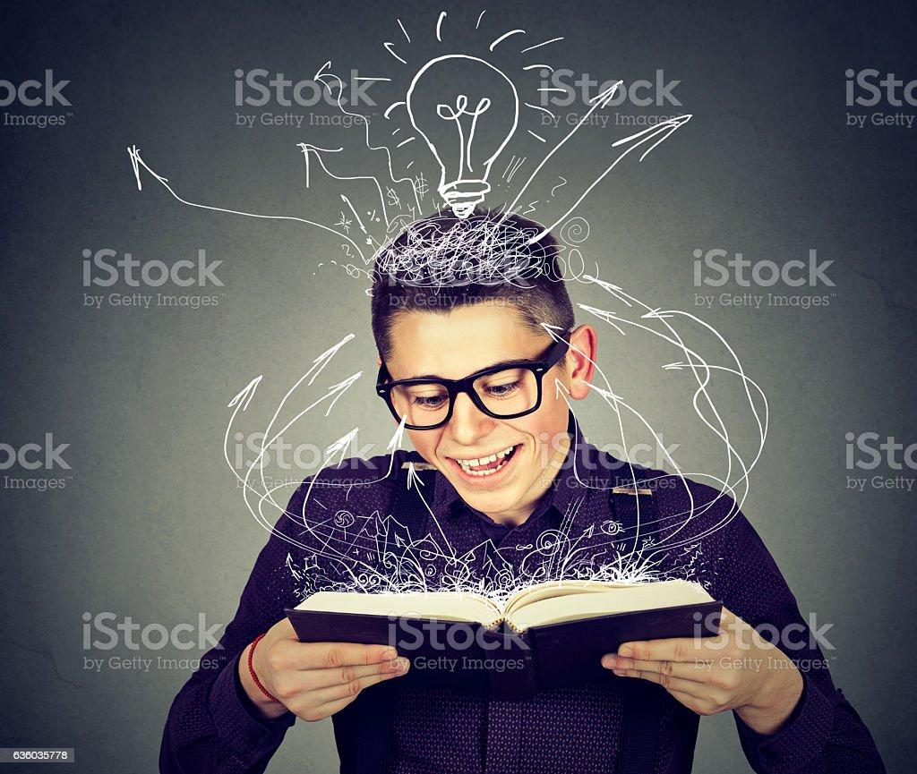 Happy man reading a book stock photo