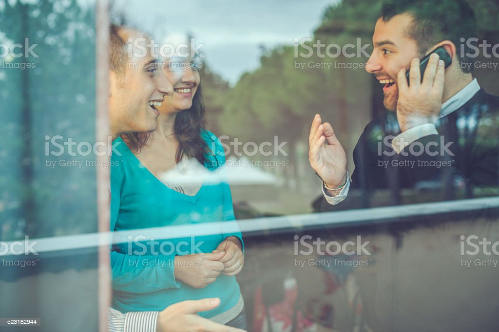 Happy man receives good news at the telephone stock photo