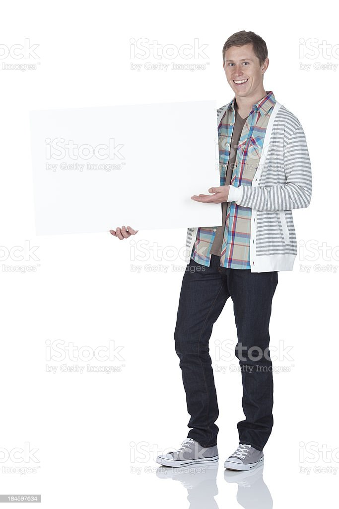 Happy man showing a placard royalty-free stock photo