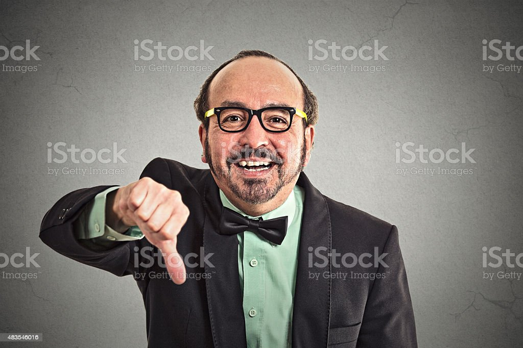 Happy man showing thumbs down hand gesture stock photo