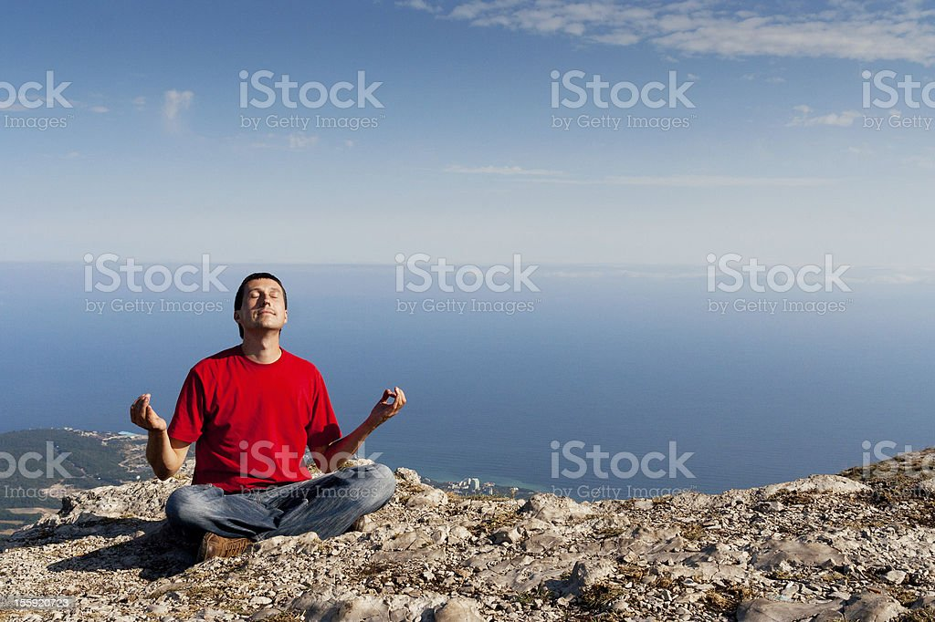 Happy man sits yoga pose royalty-free stock photo