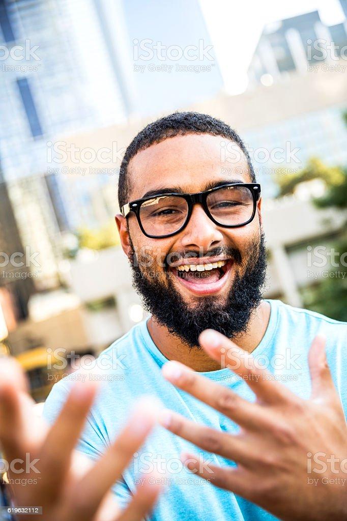 Happy man smiling and laughing at camera stock photo