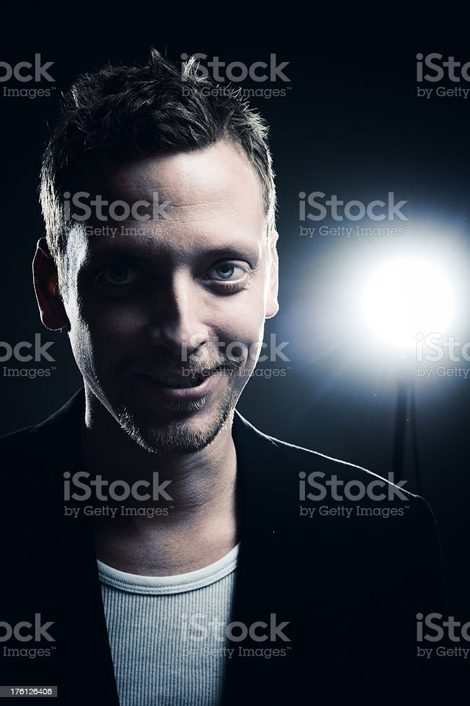 Happy man standing in the spotlight royalty-free stock photo