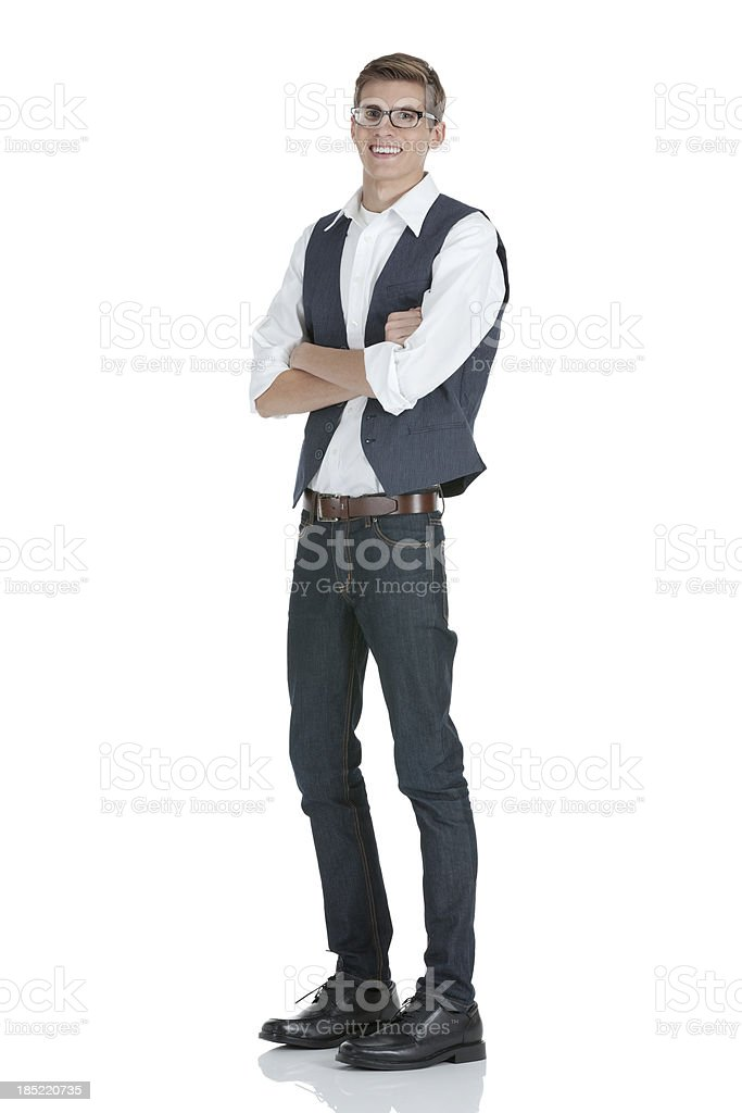 Happy man standing with his arms crossed royalty-free stock photo