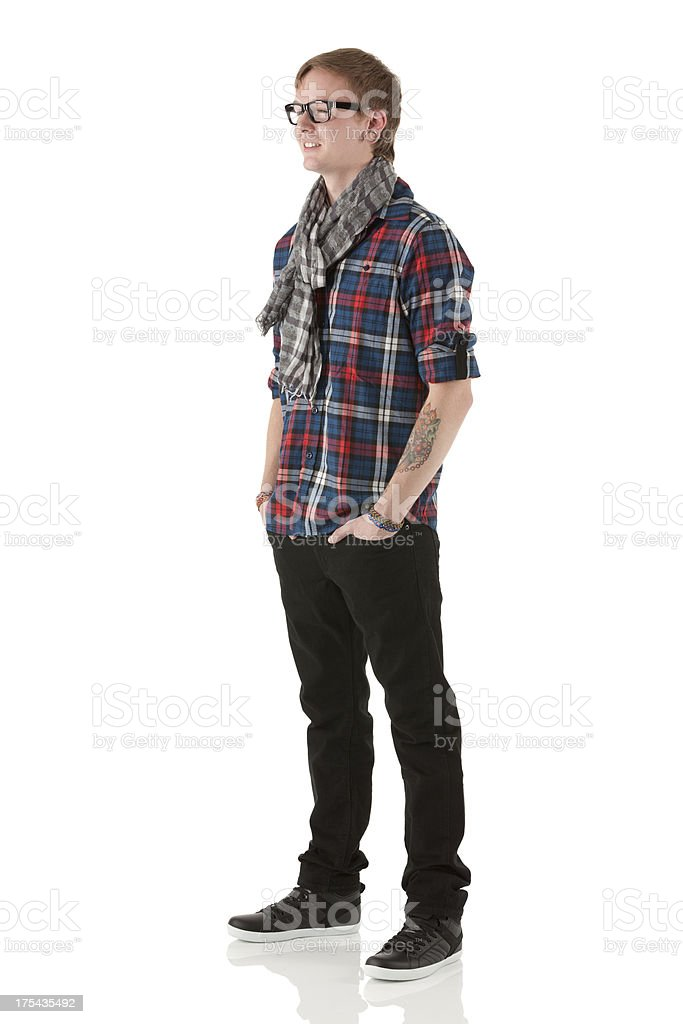 Happy man standing with his hands in pockets royalty-free stock photo