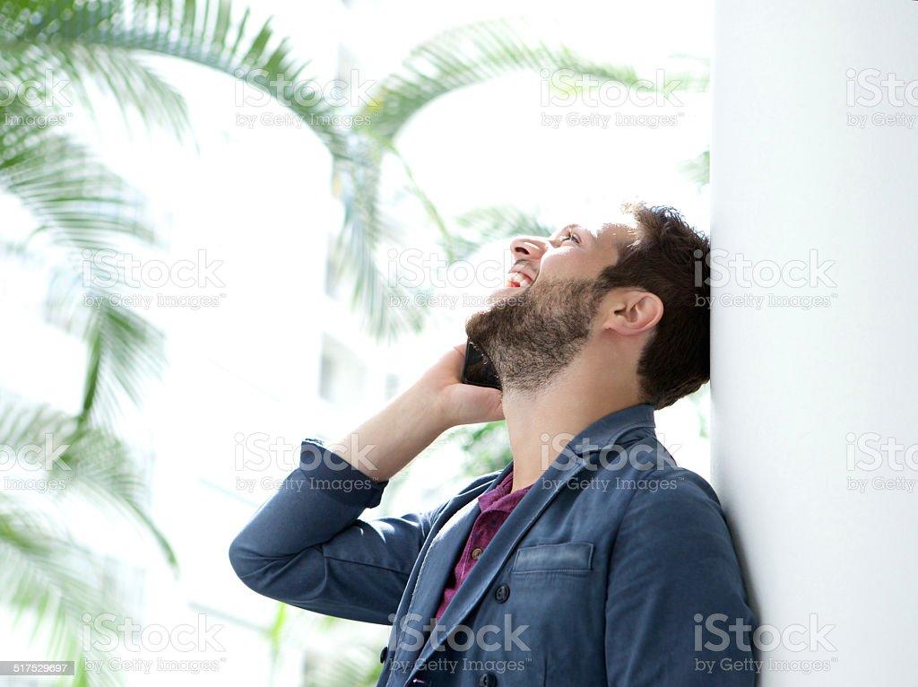 Happy man talking on mobile phone stock photo