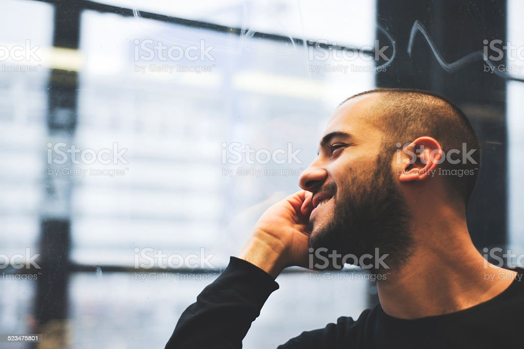 Happy man talking on the phone in train stock photo