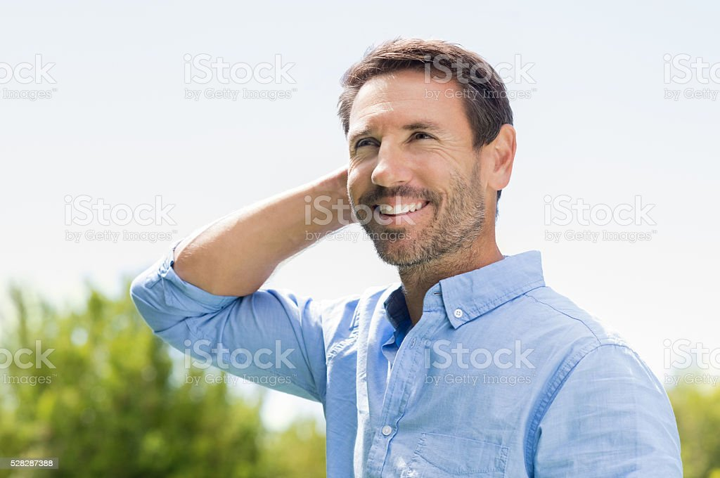 Happy man thinking stock photo