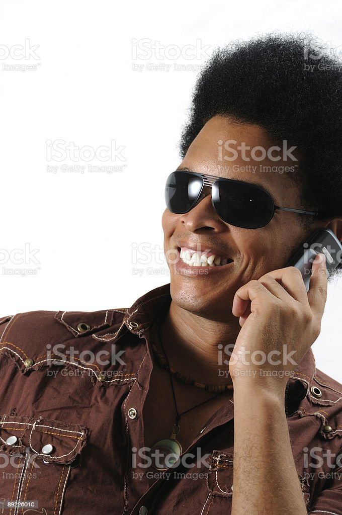 Happy man using cell phone royalty-free stock photo