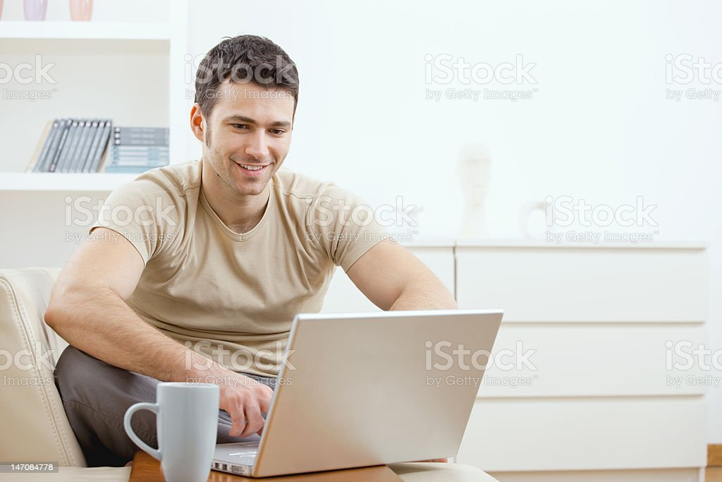 Happy man using computer stock photo