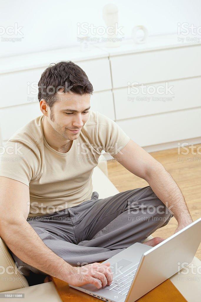 Happy man using computer royalty-free stock photo