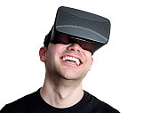 Happy man using virtual reality glasses isolated on white background