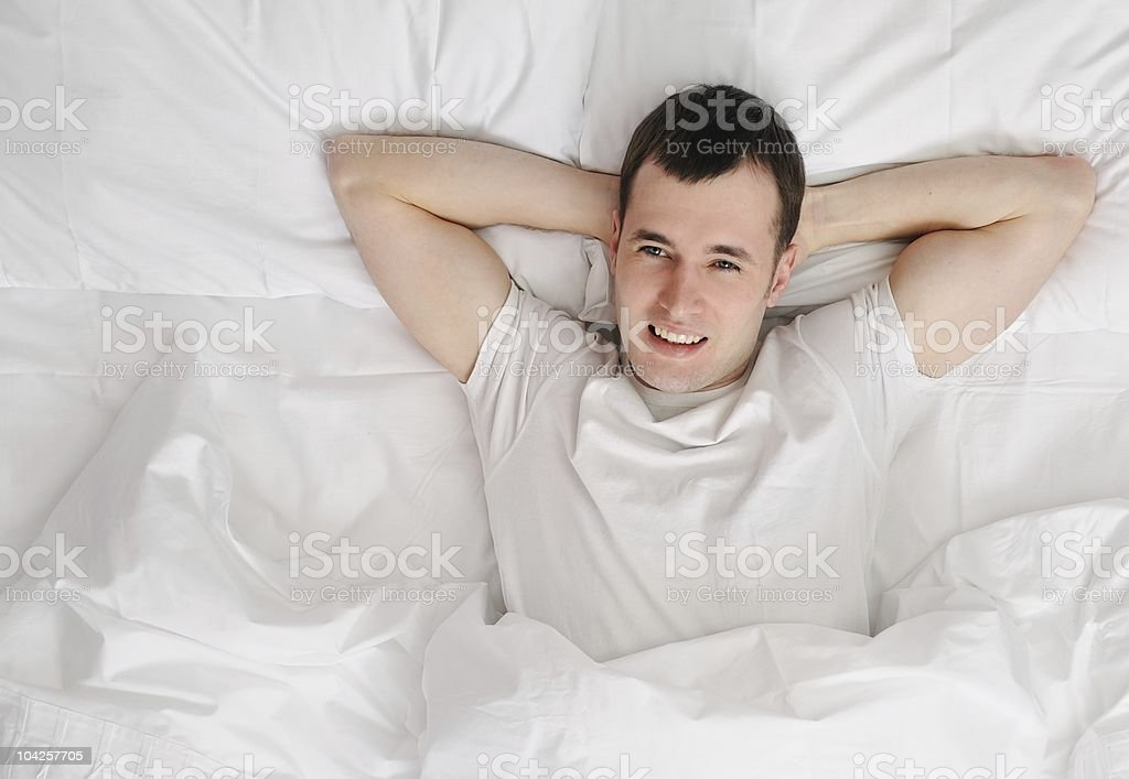 Happy man waking up stock photo