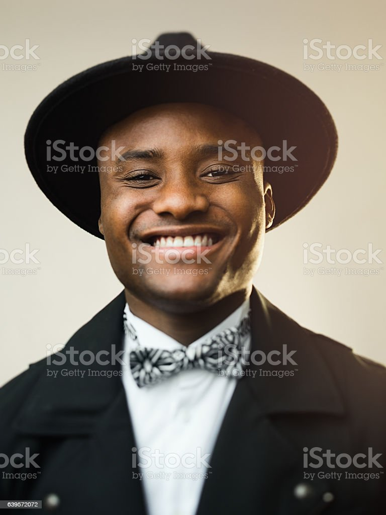 Happy man wearing black suit and hat stock photo