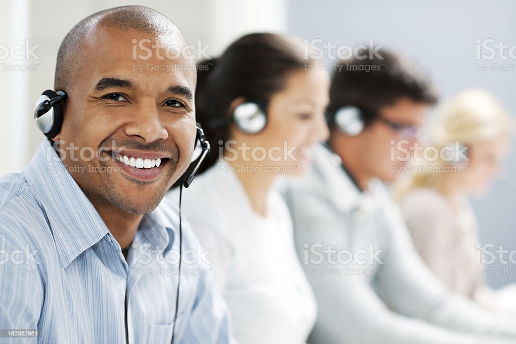 Happy man wearing headset and looking at camera stock photo