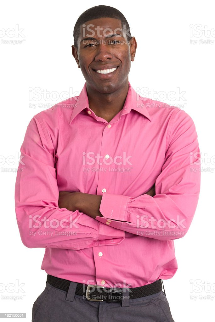 Happy man wearing pink shirt and arms crossed royalty-free stock photo