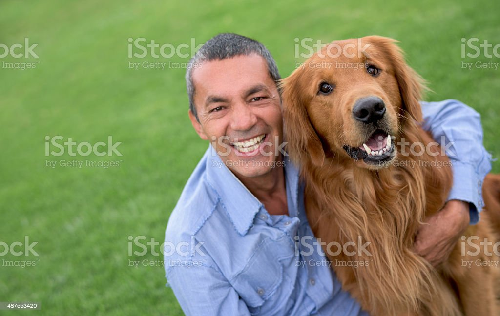 Happy man with a dog stock photo