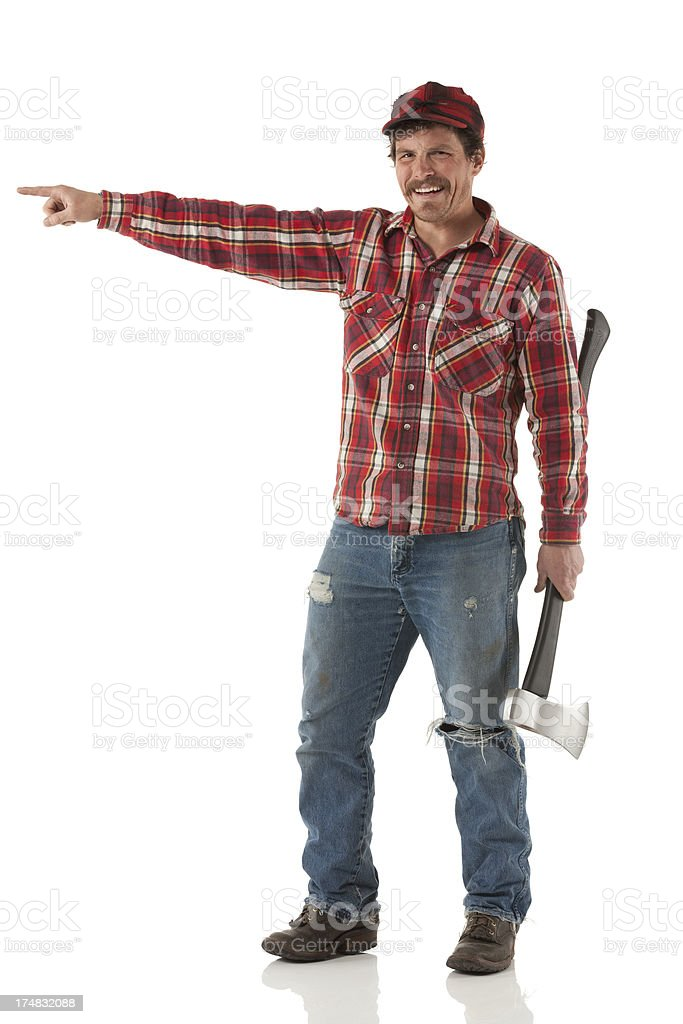 Happy man with axe and pointing royalty-free stock photo