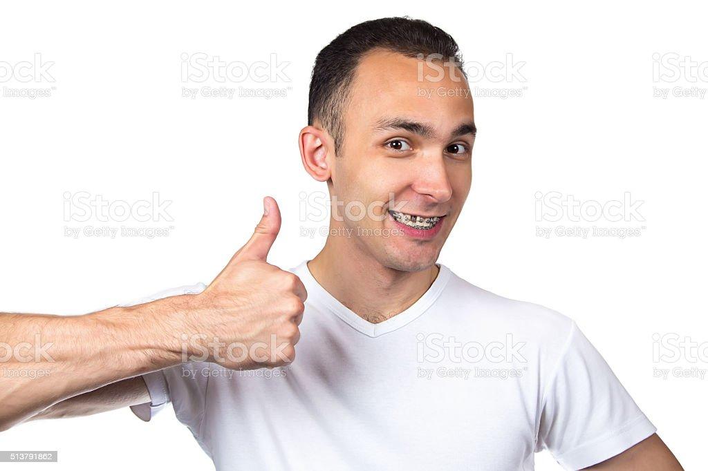 Happy man with brackets stock photo