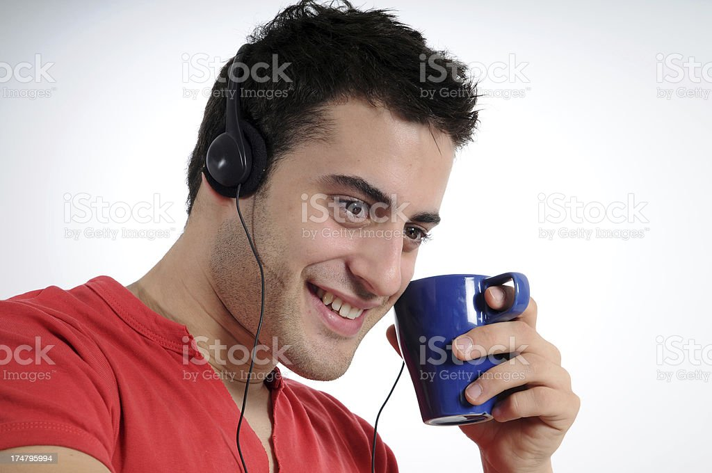 Happy Man with coffee and music royalty-free stock photo