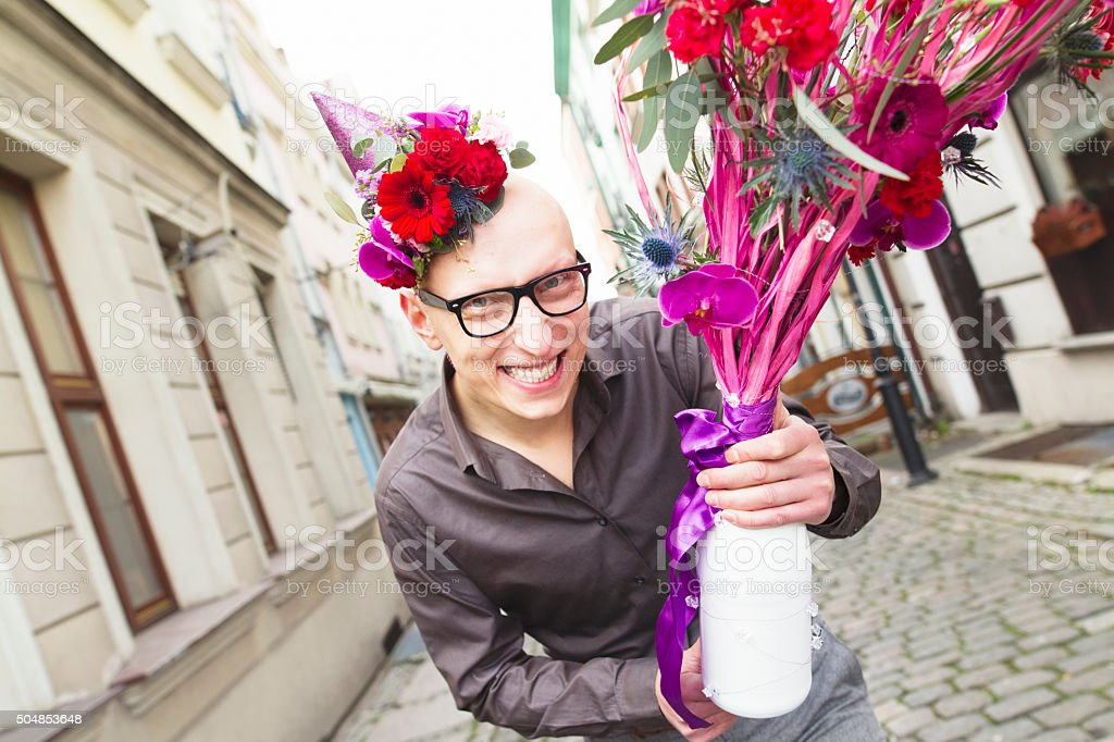 Happy man with flowers stock photo
