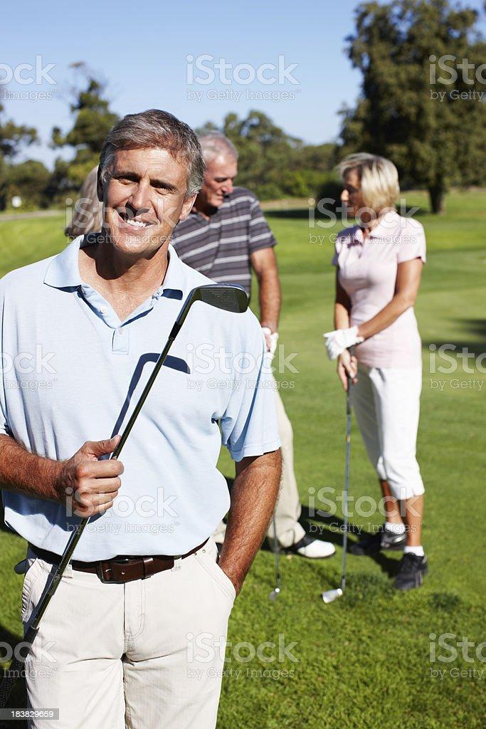 Happy man with golf club royalty-free stock photo