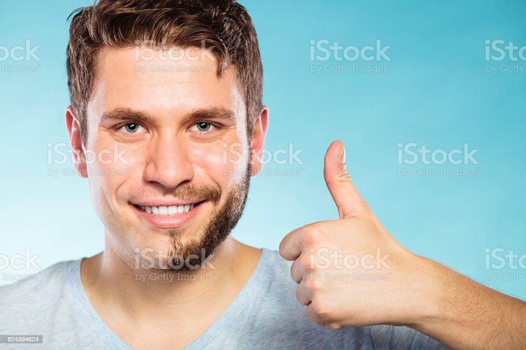 Happy man with half shaved face beard hair. stock photo