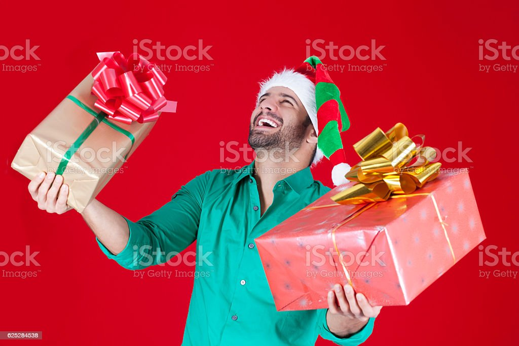 Happy man with his christmas presents stock photo