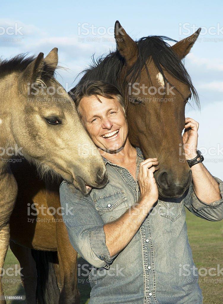 Happy man with horses royalty-free stock photo
