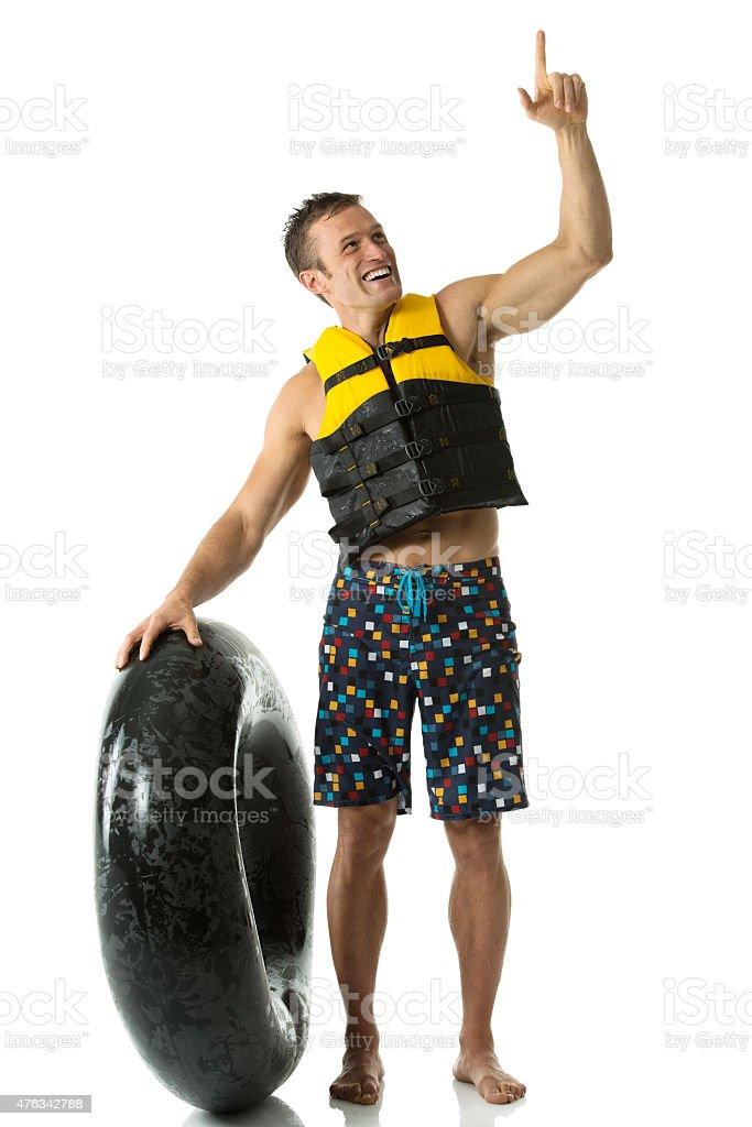 Happy man with inner tube stock photo