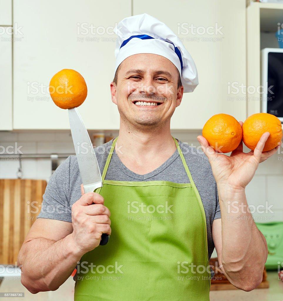 Happy man with oranges stock photo