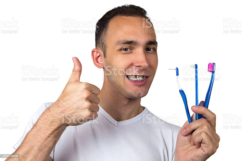 Happy man with toothbrushes stock photo