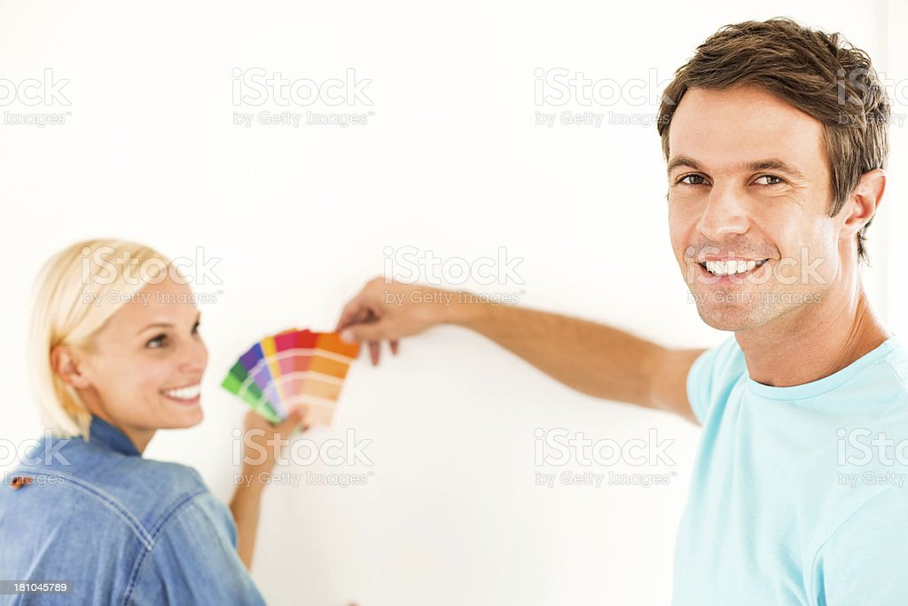 Happy Man With Woman Choosing Color From Swatches At Home royalty-free stock photo