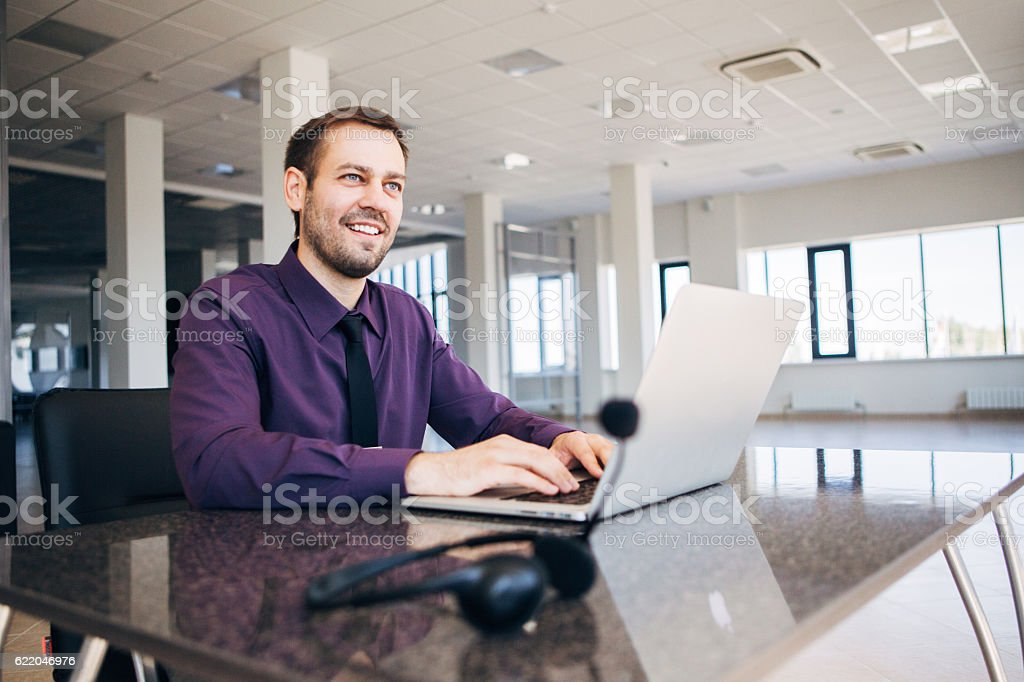 happy man working as an operator in the center of stock photo