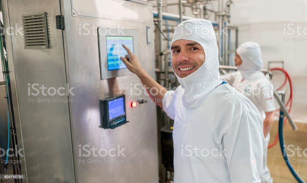 Happy man working at a food factory stock photo