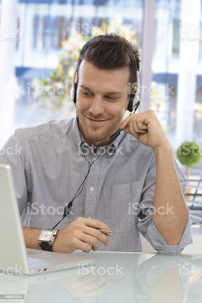 Happy man working at callcenter royalty-free stock photo