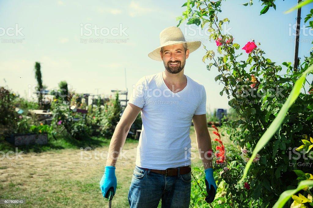 Happy man working in urban garden stock photo