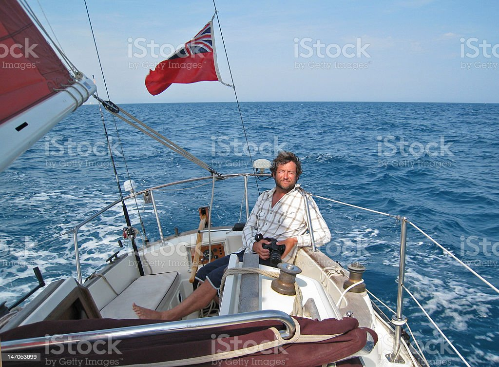 Happy man yacht sailing royalty-free stock photo