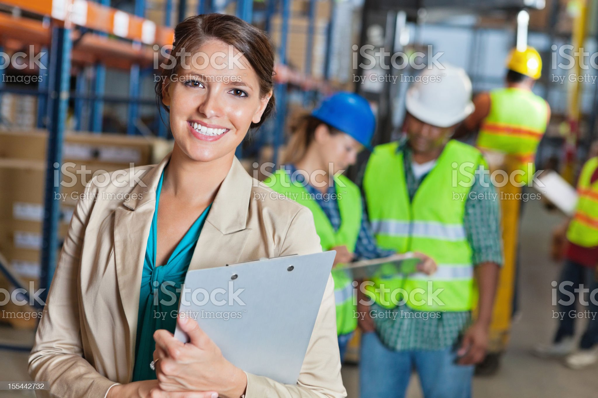Happy manager in shipping and distribution warehouse facility royalty-free stock photo