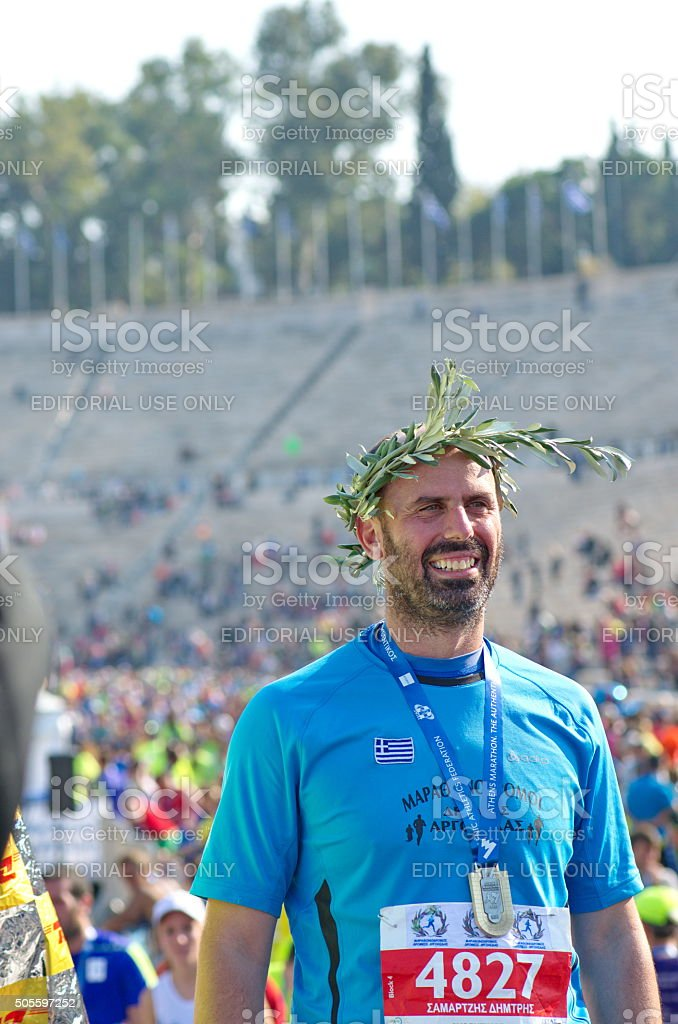 Happy marathon finisher with olympic crown stock photo