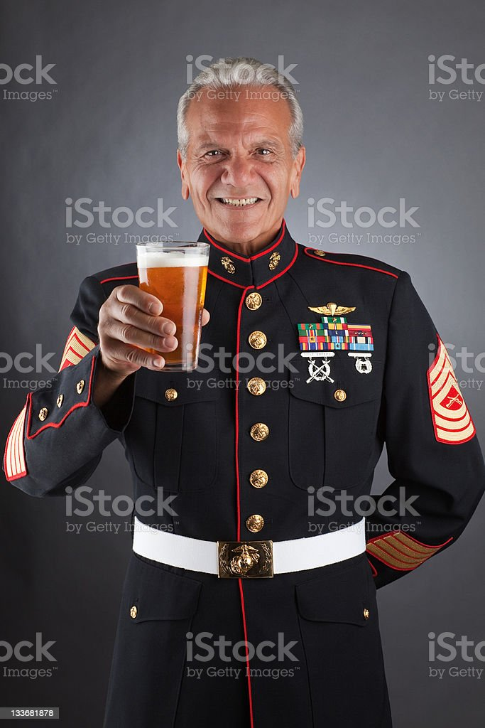 Happy Marine Holding a Beer stock photo