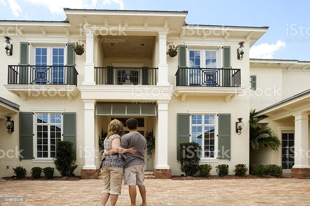 Happy Married couple shopping for a new home saying goodbye stock photo