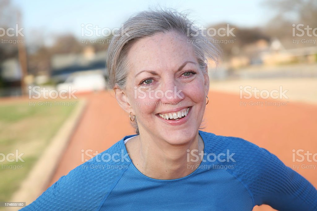 Happy Mature Adult at the Track royalty-free stock photo