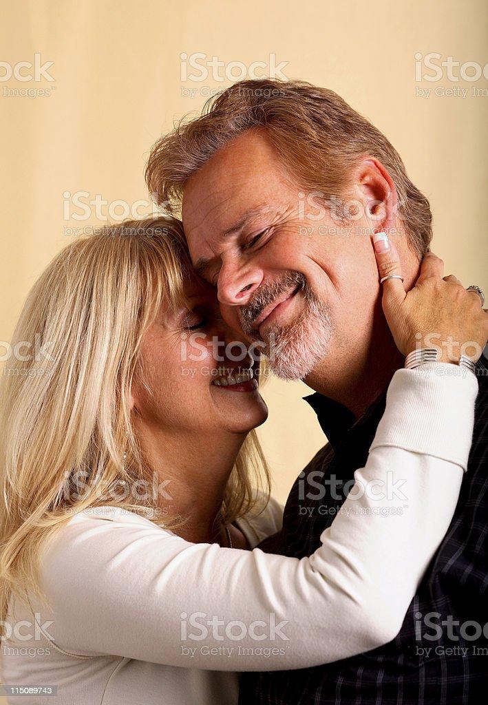 happy mature adult couple embrace portrait royalty-free stock photo